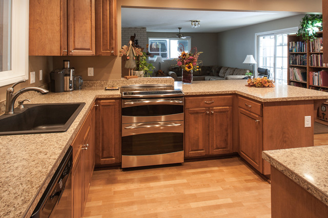 birch kitchen cabinets laminate flooring stainless steel double oven craftsman kitchen - Laminate Kitchen Flooring