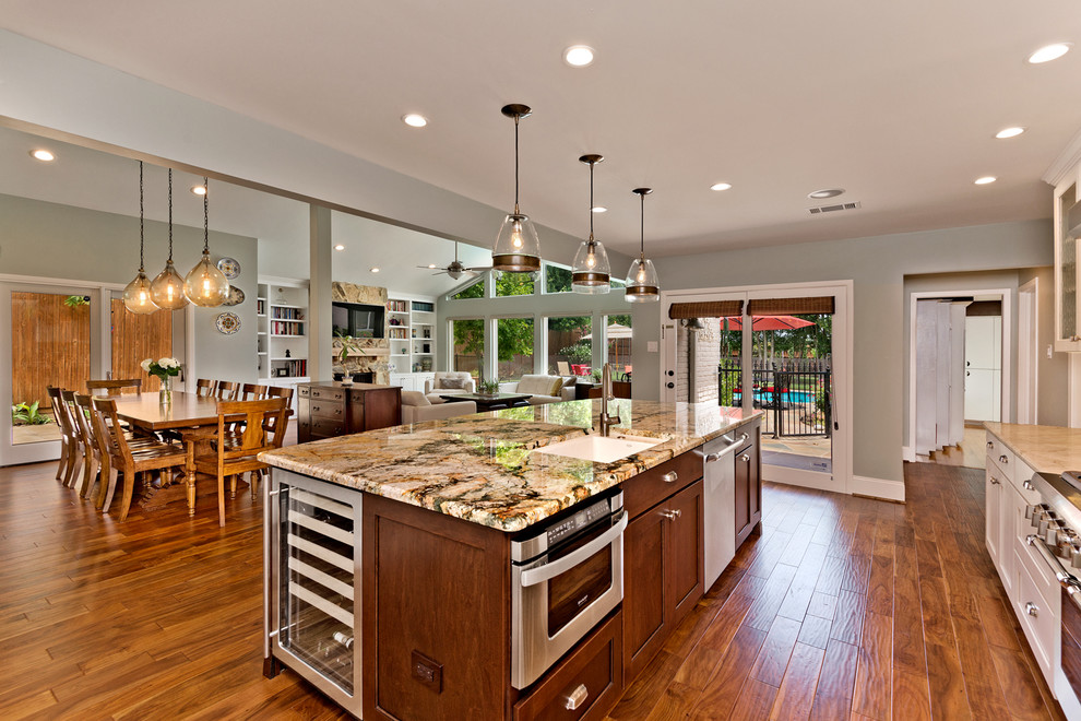 Large transitional medium tone wood floor eat-in kitchen photo in Dallas with an undermount sink, beaded inset cabinets, white cabinets, granite countertops, green backsplash, ceramic backsplash, stainless steel appliances and an island