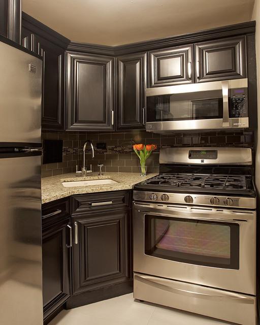 elegant kitchen photo in new york with an undermount sink raised panel cabinets - Corner Sink Kitchen