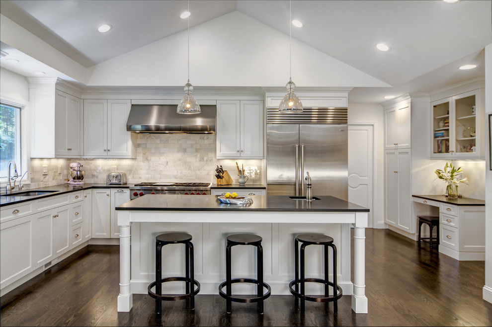 Example of a large classic l-shaped dark wood floor eat-in kitchen design in Other with an undermount sink, shaker cabinets, white cabinets, multicolored backsplash, stainless steel appliances, an island, granite countertops and marble backsplash