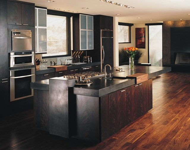 Black Concrete Countertops With Dark Walnut Floors Modern