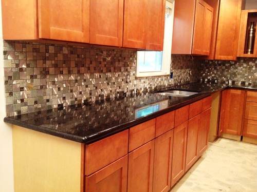 transitional New York kitchen featuring granite countertops