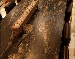 Riverwashed Cyclone Granite countertop in a Tuscan Kitchen mediterranean-kitchen-countertops