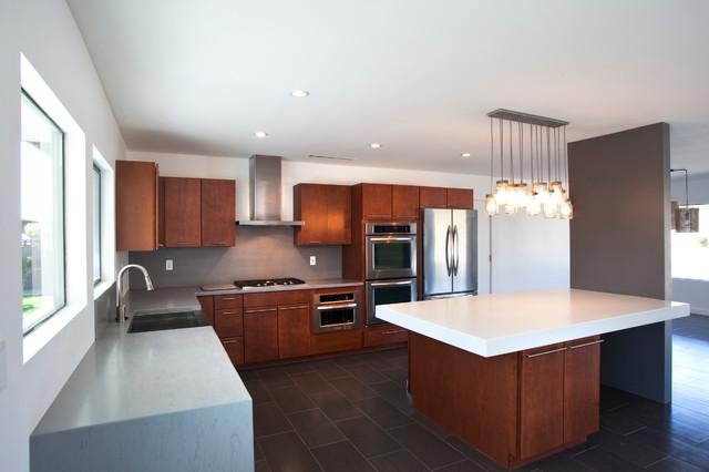 Southwestern Kitchen by Spry Architecture