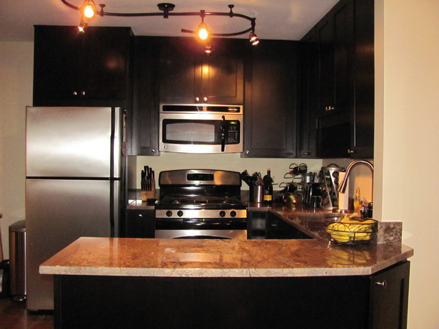 Black kitchen cabinets rockford door style cliqstudios for Black kitchen cabinet doors