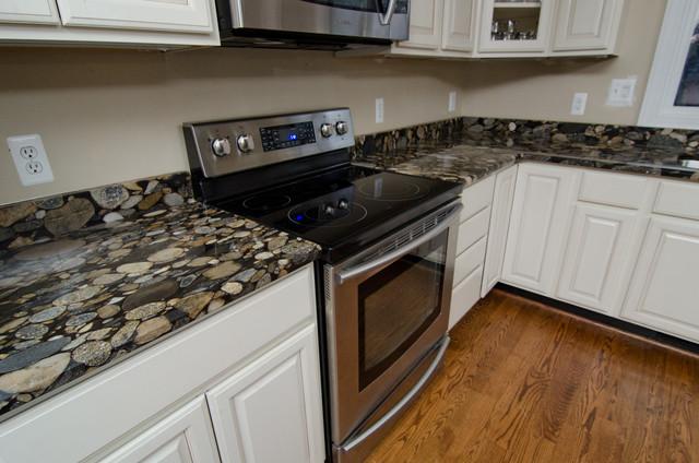 Black mosaic gold granite marinace granite kitchen for Black and gold kitchen