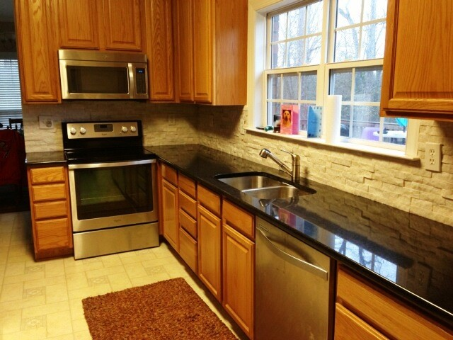 Black Pearl Granite On Medium Wood Cabinets Traditional