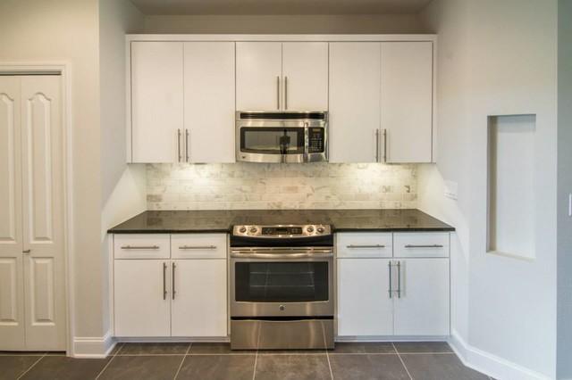 Black Pearl granite w/ white marble backsplash