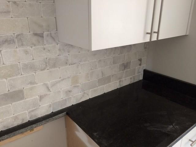 black pearl granite w white marble backsplash kitchen