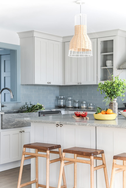 Mid-sized minimalist l-shaped medium tone wood floor open concept kitchen photo in Portland Maine with an integrated sink, shaker cabinets, gray cabinets, granite countertops, blue backsplash, brick backsplash, stainless steel appliances, an island and gray countertops