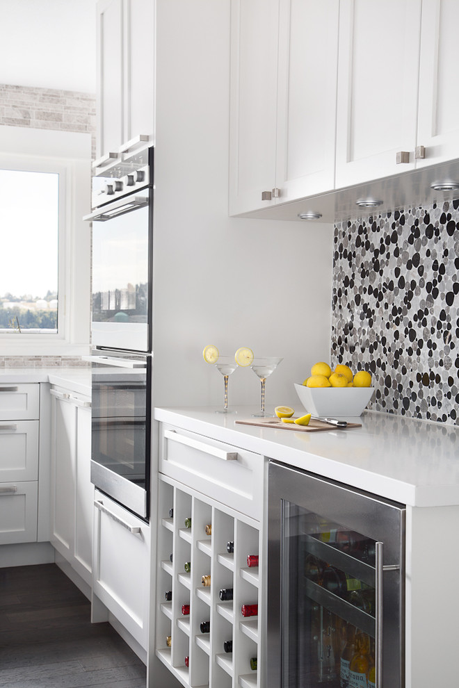 Inspiration for a contemporary kitchen remodel in Vancouver with mosaic tile backsplash, stainless steel appliances, white cabinets and recessed-panel cabinets