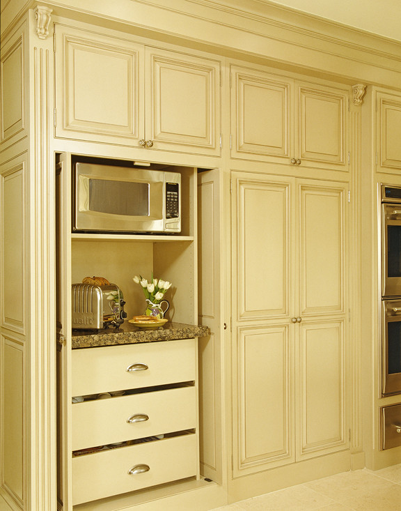 Eat-in kitchen - large traditional l-shaped ceramic tile eat-in kitchen idea in Detroit with an undermount sink, beaded inset cabinets, beige cabinets, granite countertops, paneled appliances and an island