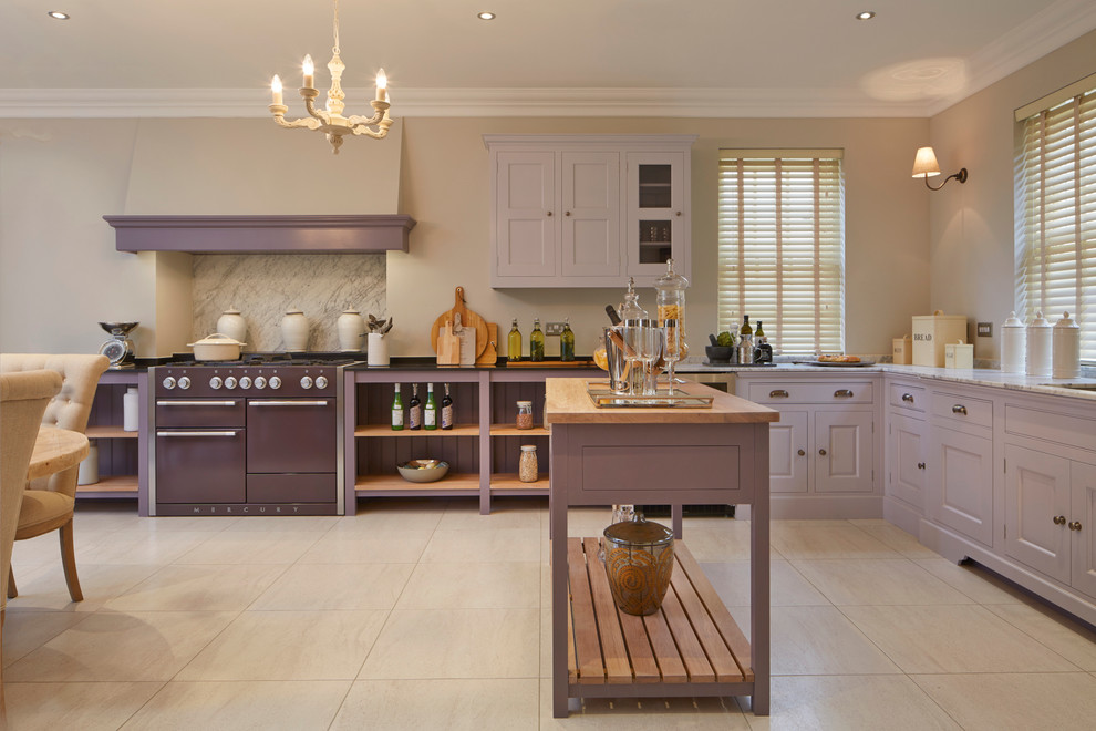 Example of a large classic l-shaped porcelain tile eat-in kitchen design in Wiltshire with an undermount sink, raised-panel cabinets, marble countertops, colored appliances and an island