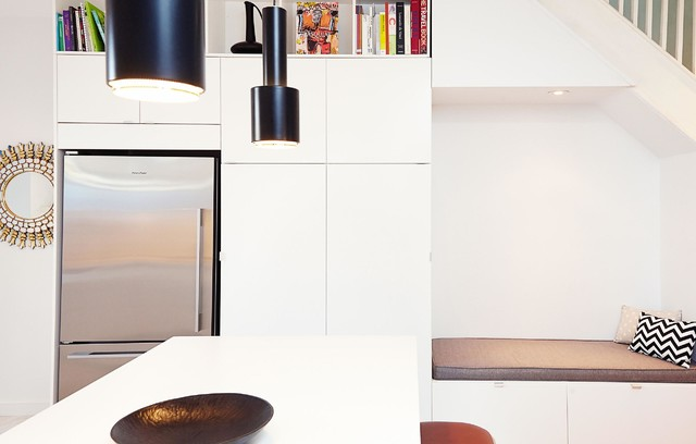 Example of a mid-sized minimalist u-shaped marble floor open concept kitchen design in Toronto with an undermount sink, flat-panel cabinets, white cabinets, solid surface countertops, gray backsplash, stone slab backsplash, stainless steel appliances and a peninsula