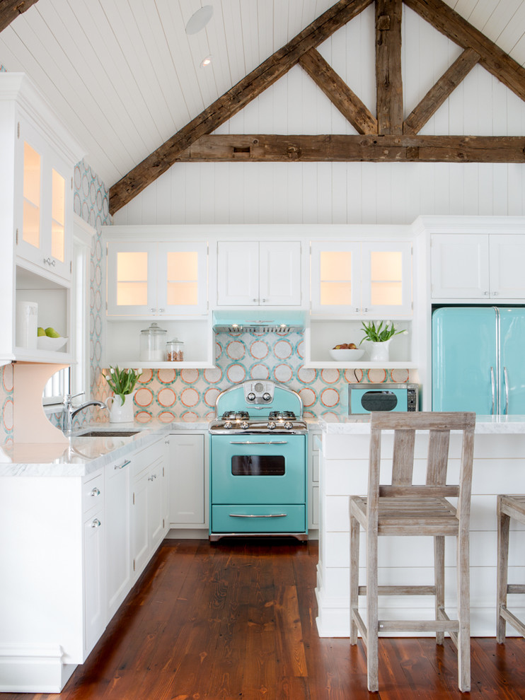 Small beach style l-shaped medium tone wood floor open concept kitchen photo in St Louis with white cabinets, multicolored backsplash, colored appliances, an island, an undermount sink, beaded inset cabinets, quartz countertops and mosaic tile backsplash