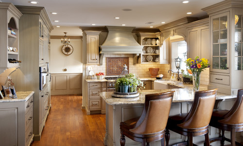 Is the crown moulding color different in the back hall & over the cooktop or is a matter of ...