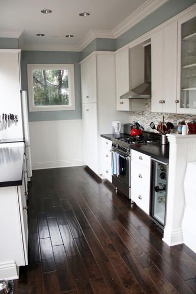 Blue Gray Kitchen With Black Counter Tops And White Cabinets