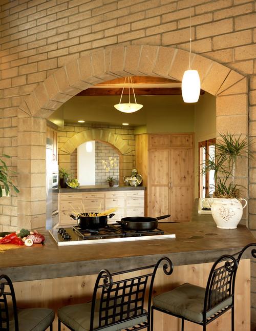 Tuscan style kitchen concrete countertops.