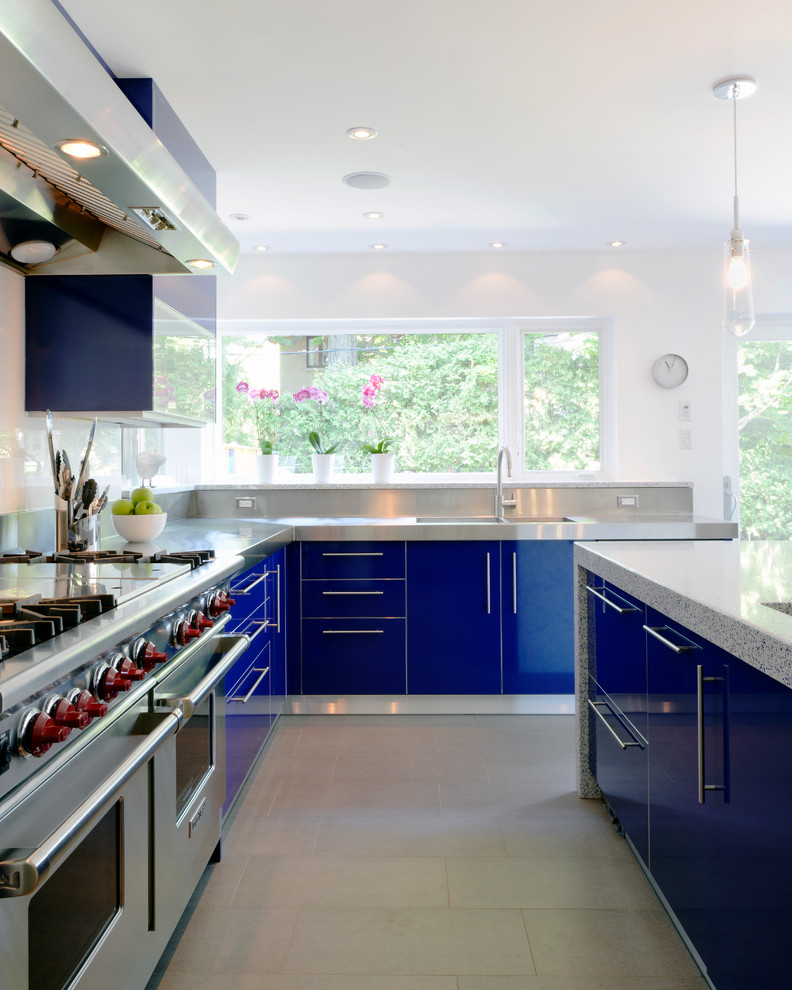 Trendy kitchen photo in Ottawa with stainless steel appliances, an integrated sink, stainless steel countertops, flat-panel cabinets and blue cabinets