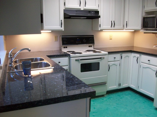 Blue pearl granite for White kitchen cabinets with blue pearl granite