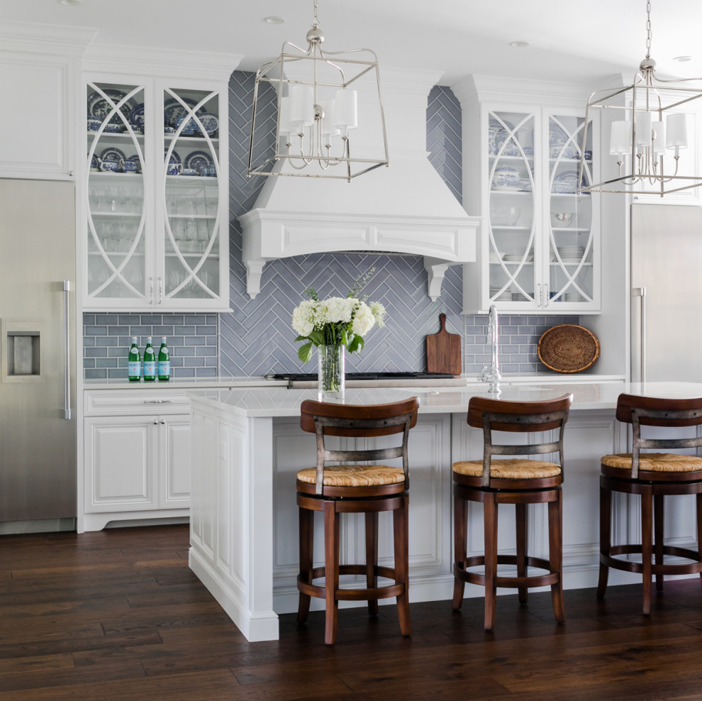 Kitchen - large coastal l-shaped dark wood floor and brown floor kitchen idea in Jacksonville with raised-panel cabinets, white cabinets, gray backsplash, an island and white countertops