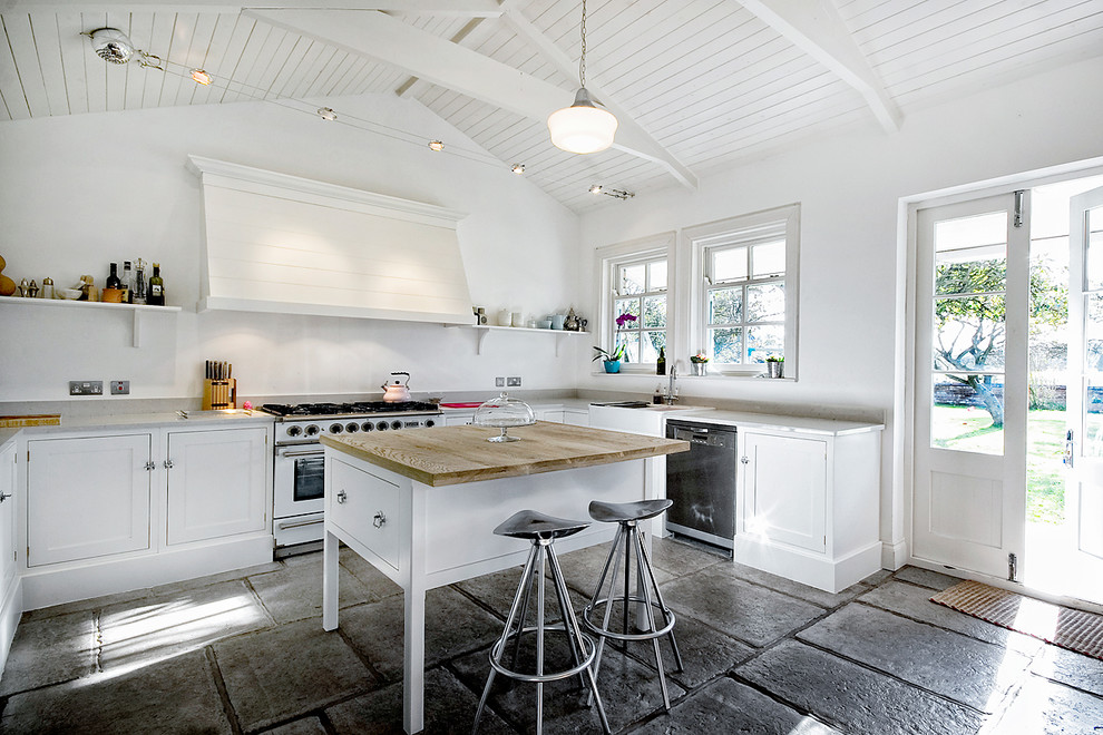Inspiration for a country u-shaped kitchen remodel in Other with a farmhouse sink, recessed-panel cabinets, white cabinets, stainless steel appliances and an island