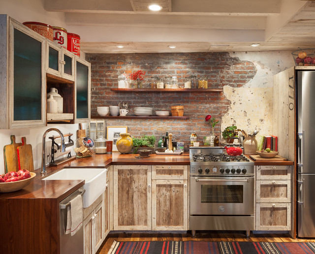 Inspiration for a small rustic l-shaped medium tone wood floor and brown floor eat-in kitchen remodel in Philadelphia with a farmhouse sink, shaker cabinets, light wood cabinets, wood countertops, red backsplash, brick backsplash, stainless steel appliances, no island and brown countertops