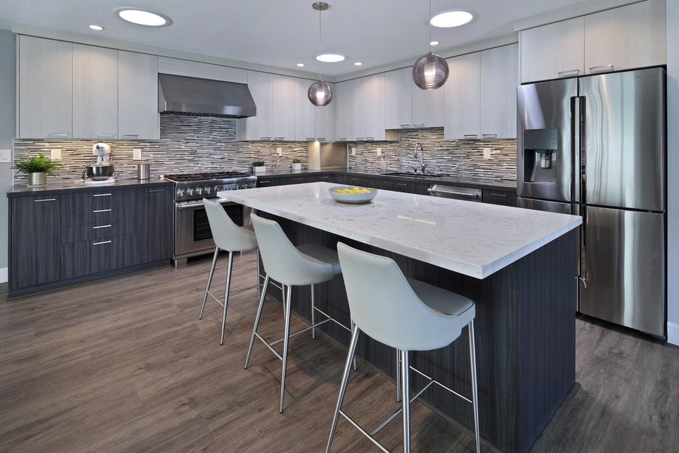 Inspiration for a mid-sized contemporary l-shaped gray floor and laminate floor eat-in kitchen remodel in Orange County with flat-panel cabinets, porcelain backsplash, stainless steel appliances, an island, an undermount sink, dark wood cabinets, quartz countertops and multicolored backsplash
