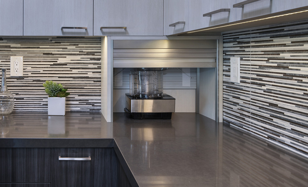 Inspiration for a mid-sized contemporary l-shaped gray floor and laminate floor eat-in kitchen remodel in Orange County with flat-panel cabinets, gray cabinets, porcelain backsplash, stainless steel appliances, an island, an undermount sink, quartz countertops and multicolored backsplash