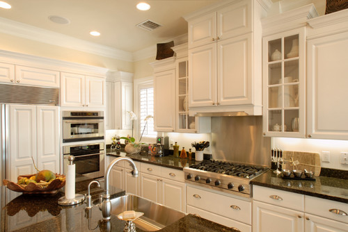 What sheen are the cabinets painted, satin, semi-gloss? Also can you ...