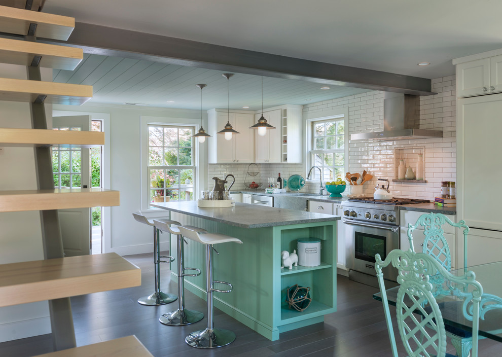 Example of a mid-sized coastal l-shaped eat-in kitchen design in Providence with white backsplash, subway tile backsplash and an island