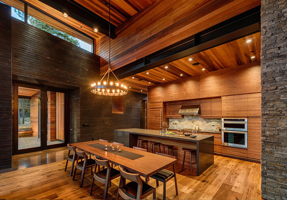 Trendy galley eat-in kitchen photo in San Francisco with flat-panel cabinets, medium tone wood cabinets, multicolored backsplash, mosaic tile backsplash and stainless steel appliances