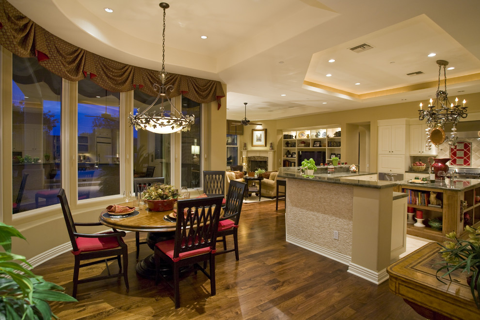 Inspiration for a mid-sized timeless u-shaped ceramic tile open concept kitchen remodel in Phoenix with a drop-in sink, raised-panel cabinets, white cabinets, granite countertops, gray backsplash, ceramic backsplash, stainless steel appliances and an island