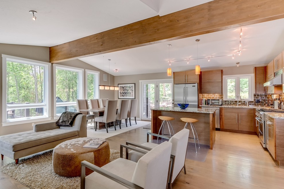 Open concept kitchen - contemporary l-shaped open concept kitchen idea in Denver with flat-panel cabinets, medium tone wood cabinets, brown backsplash, subway tile backsplash and stainless steel appliances