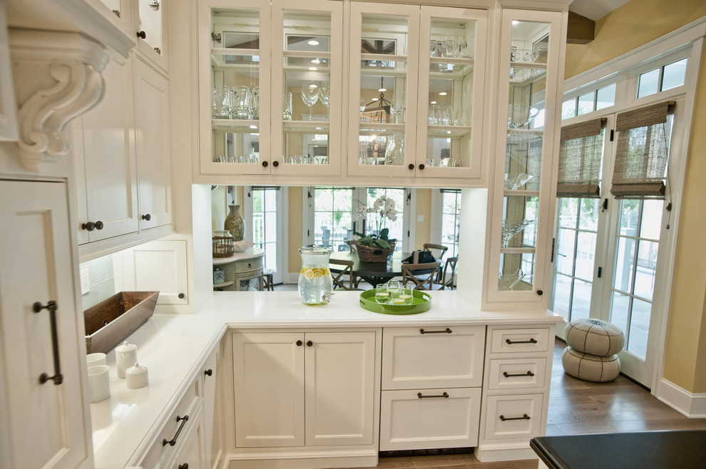 Inspiration for a timeless kitchen remodel in Los Angeles with glass-front cabinets and white cabinets