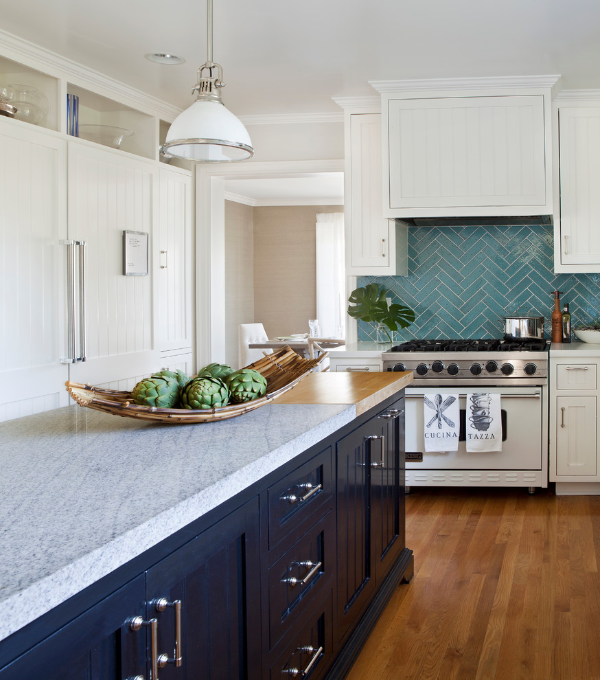 Inspiration for a mid-sized timeless l-shaped medium tone wood floor kitchen remodel in Los Angeles with beaded inset cabinets, white cabinets, marble countertops, blue backsplash, cement tile backsplash, white appliances and an island