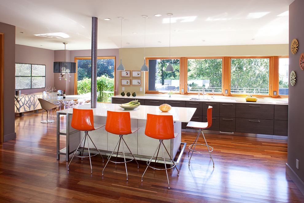 Large trendy galley medium tone wood floor and brown floor open concept kitchen photo in San Francisco with quartz countertops, an undermount sink, flat-panel cabinets, stainless steel appliances and an island