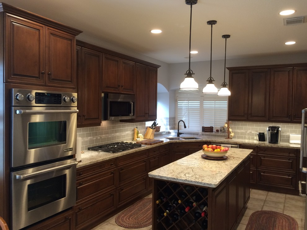 Bright kitchen featuring dark stained cabinets with light ...