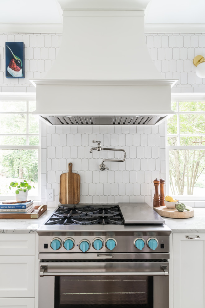 Eat-in kitchen - large coastal galley dark wood floor and brown floor eat-in kitchen idea in Atlanta with an undermount sink, shaker cabinets, white cabinets, quartzite countertops, white backsplash, marble backsplash, paneled appliances, an island and white countertops