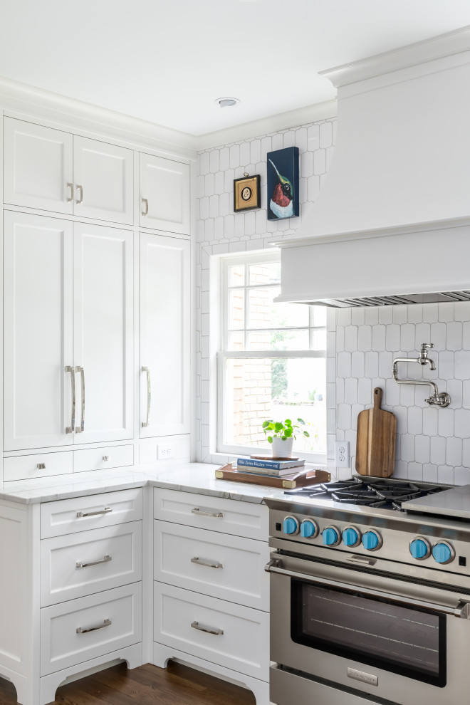 Large beach style galley dark wood floor and brown floor eat-in kitchen photo in Atlanta with an undermount sink, shaker cabinets, white cabinets, quartzite countertops, white backsplash, marble backsplash, paneled appliances, an island and white countertops