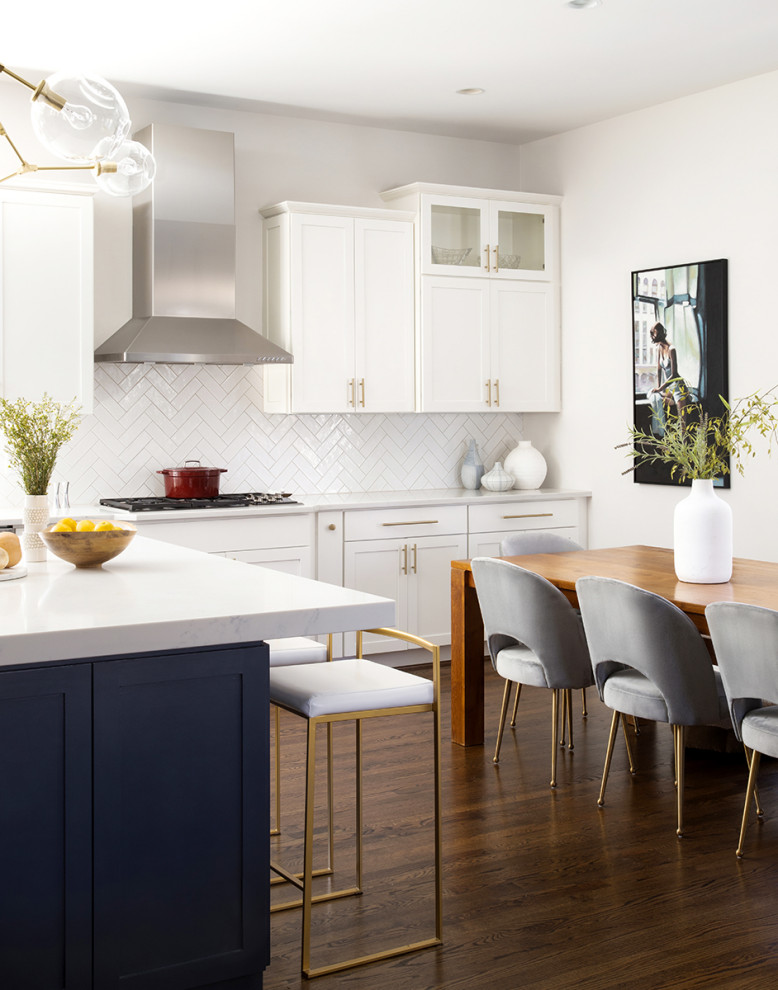 Inspiration for a mid-sized transitional l-shaped medium tone wood floor and brown floor open concept kitchen remodel in DC Metro with an undermount sink, recessed-panel cabinets, white cabinets, quartz countertops, white backsplash, subway tile backsplash, stainless steel appliances, an island and white countertops