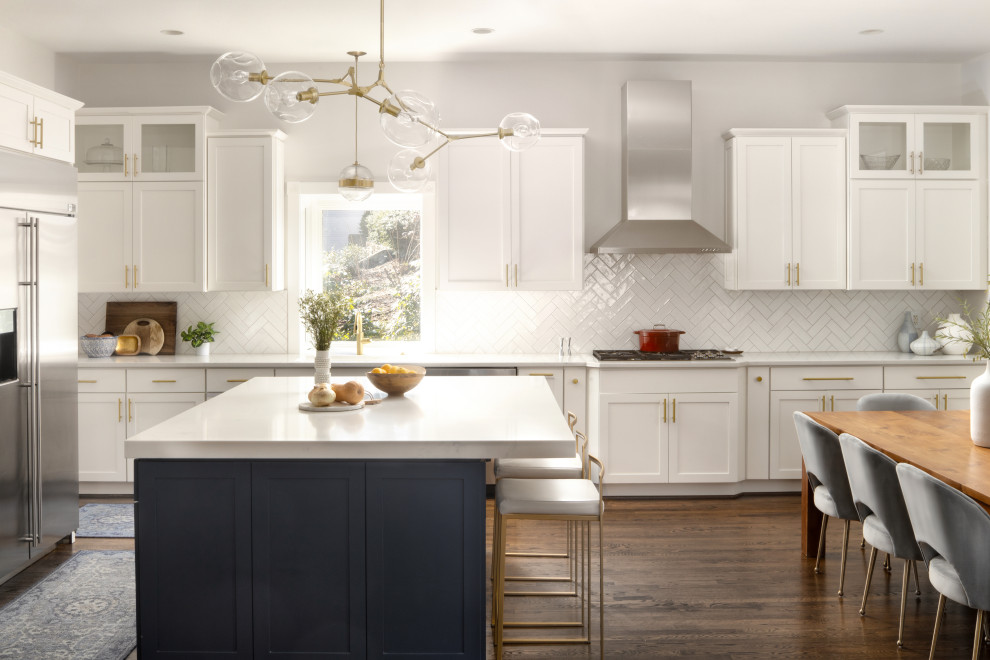 Mid-sized transitional l-shaped medium tone wood floor and brown floor open concept kitchen photo in DC Metro with an undermount sink, recessed-panel cabinets, white cabinets, quartz countertops, white backsplash, subway tile backsplash, stainless steel appliances, an island and white countertops