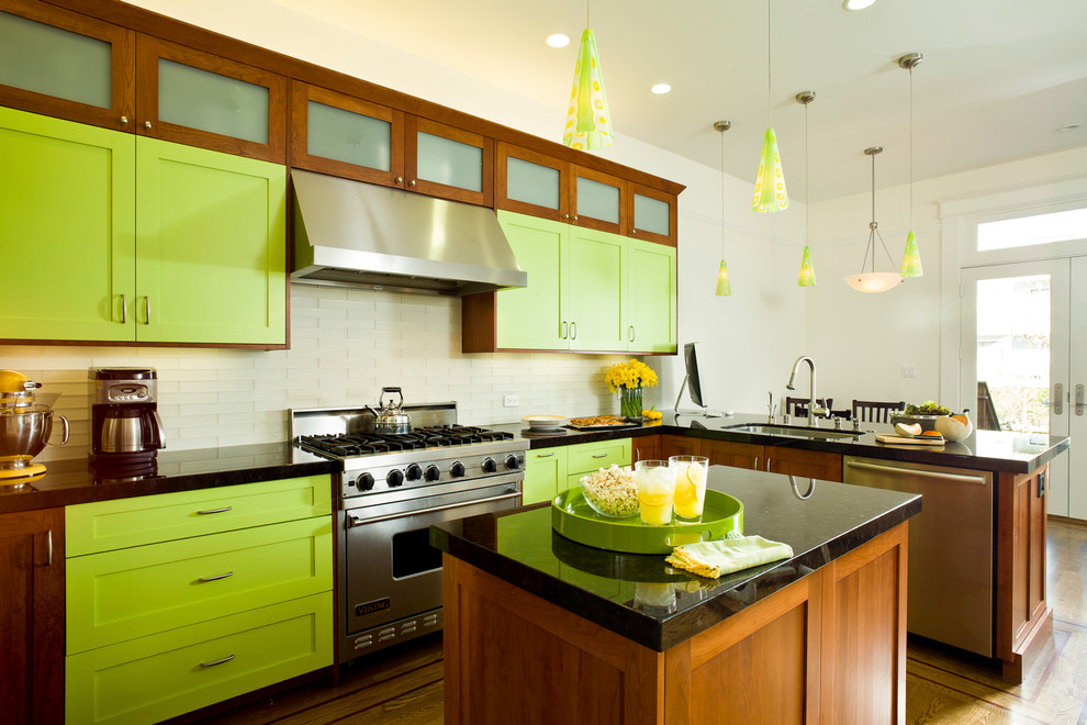 Example of an eclectic kitchen design in San Francisco with stainless steel appliances