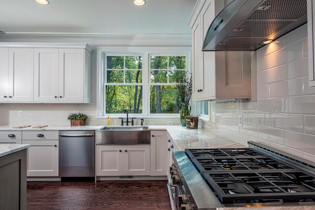 Bright white kitchen with stainless steel appliances and - Corner windows in kitchen ...
