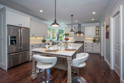 Bright White Kitchen with Stainless Steel Appliances and Oversized Island
