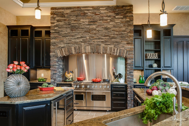 Inspiration for a timeless kitchen remodel in Detroit with stainless steel  appliances, metallic backsplash,