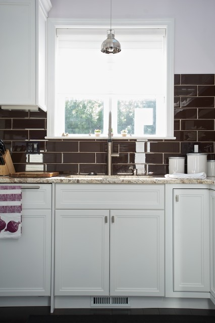 Brilliant White Kitchen Shines Bright With Layers of Dynamic Detail contemporary-kitchen