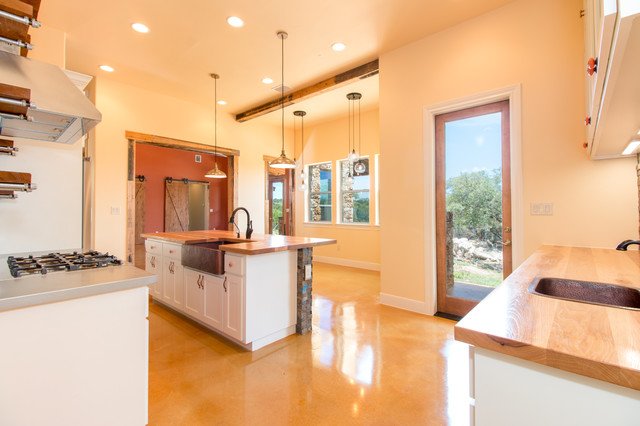 Example of a mountain style kitchen design in Austin