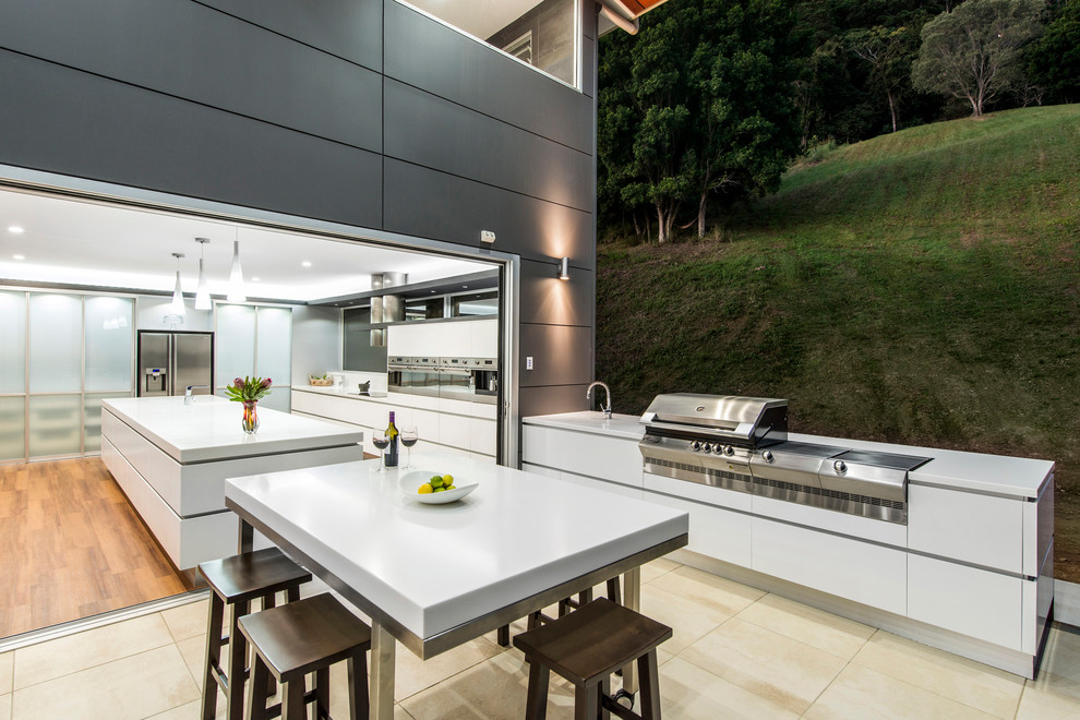 Inspiration for a contemporary kitchen remodel in Brisbane with flat-panel cabinets