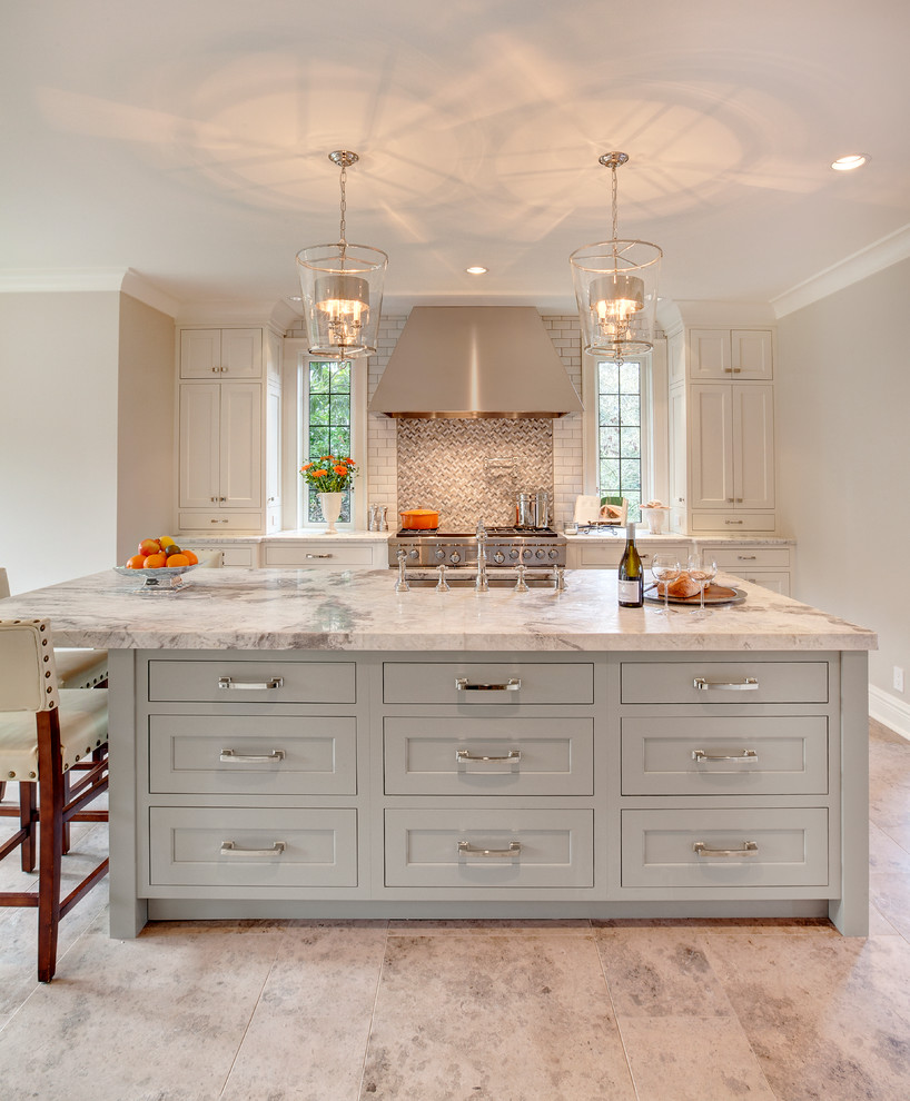 Inspiration for a transitional kitchen remodel in Seattle with an island and white countertops